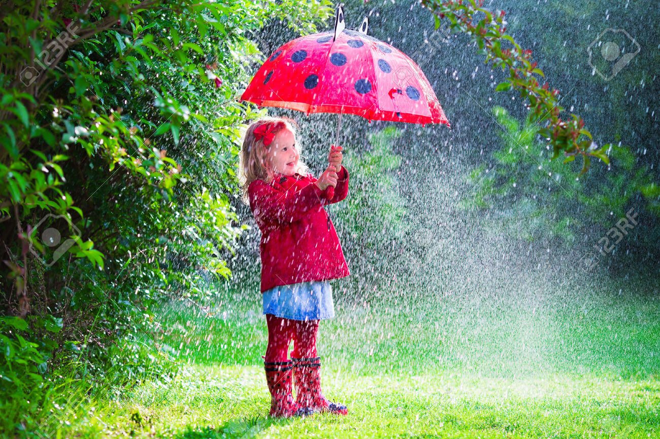 41607821-Little-girl-with-red-umbrella-playing-in-the-rain